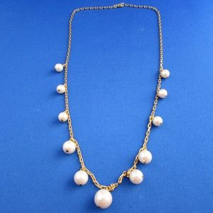 goldtone necklace with dangling pearl drops